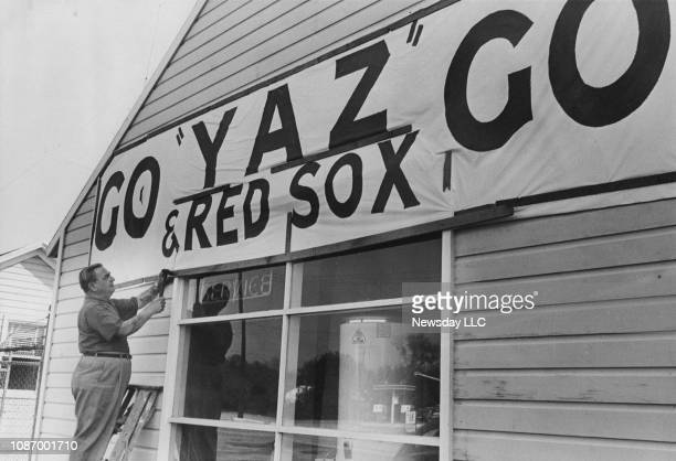 Jack Struthworlf of W.C. Esp Oil Co. In Bridgehampton, New York hangs a sign across the shop rooting for Carl Yastrzemski and the Boston Red Sox in...