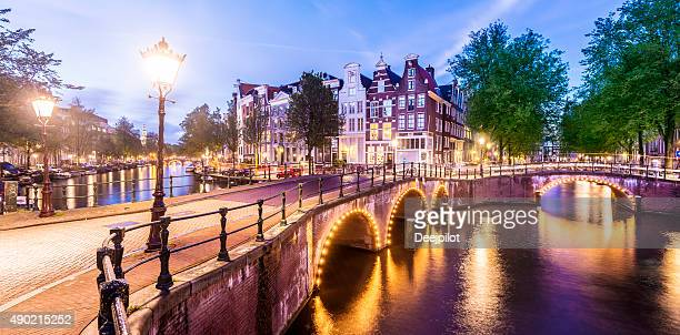 Bridges and Canals of Amsterdam Illuminated at Sunset Holland