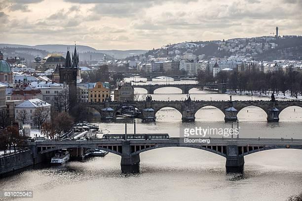 Bridges including the Charles Bridge center cross the Vltava river in Prague Czech Republic on Thursday Jan 5 2017 The Czech Republic posted its...