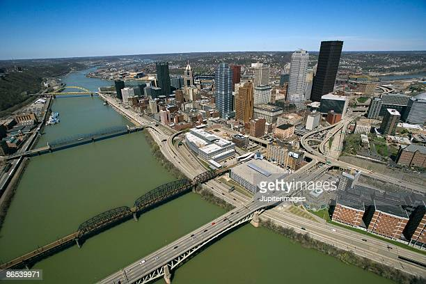 Bridges over river by cityscape of Pittsburgh