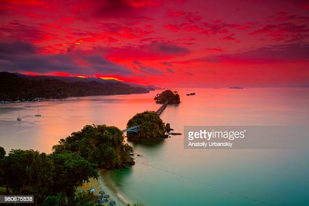 bridges over sea at sunrise, samana, dominican republic - dominican republic stock pictures, royalty-free photos & images