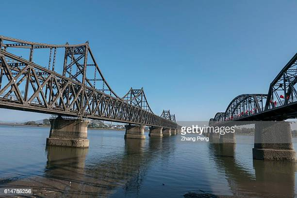 Bridges over the Yalu River connecting China and North Korea The left one named SinoKorea Friendship Bridge is used for transporting cargos by trucks...