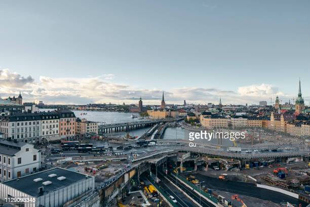 bridges, railway tracks, church tower, cityscape and water canal, stockholm, sweden - stockholm stock pictures, royalty-free photos & images