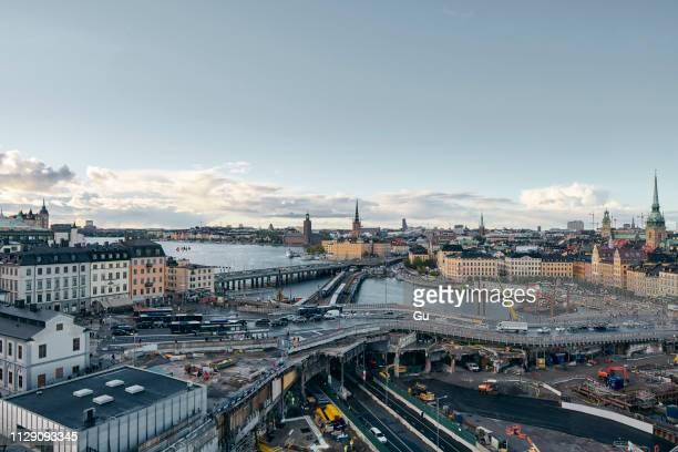 bridges, railway tracks, church tower, cityscape and water canal, stockholm, sweden - stockholm bildbanksfoton och bilder