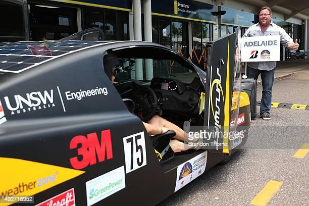 Bridgestone ambassador Shane Jacobson poses in front of the UNSW Solar Racing Team Sunswift during the 2015 Bridgestone World Solar Challenge at...