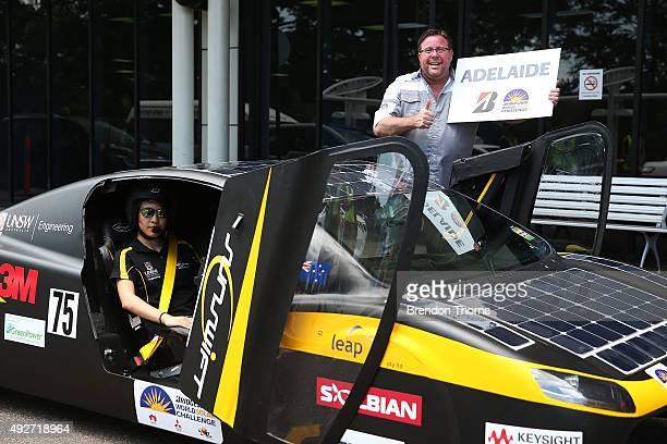 Bridgestone ambassador Shane Jacobson poses with the UNSW Solar Racing Team Sunswift during the 2015 Bridgestone World Solar Challenge at Darwin...