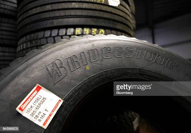Bridgestone truck tires are seen in a garage in Bonn, Germany, Tuesday, June 27, 2006. Bridgestone Corp., the world's second-biggest maker of tires,...