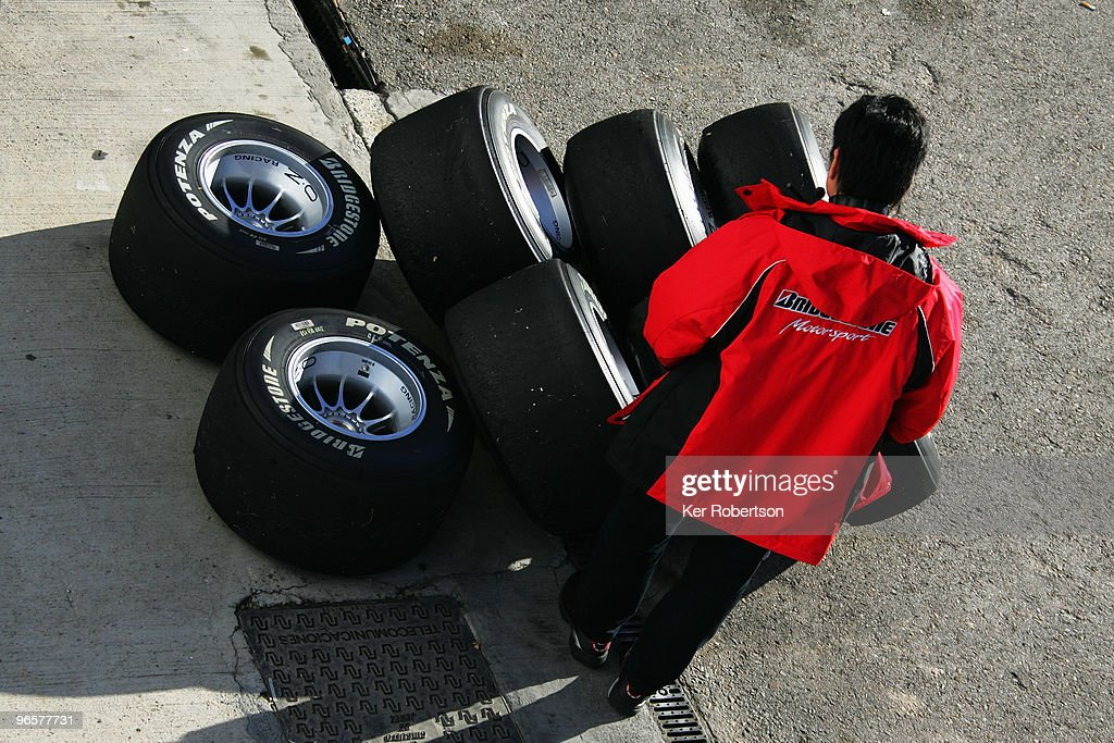 Bridgestone tyre technician examines slick tyres following winter