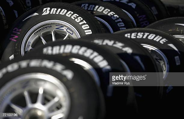 Bridgestone tyres are seen lined up in the paddock after the second practice session for the Japanese Formula One Grand Prix at the Suzuka Circuit on...