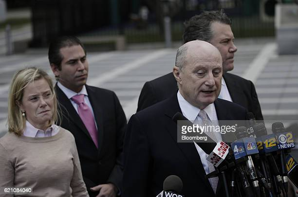 Bridget Anne Kelly former deputy chief of staff for New Jersey Governor Chris Christie left reacts as attorney Michael Critchley speaks to members of...