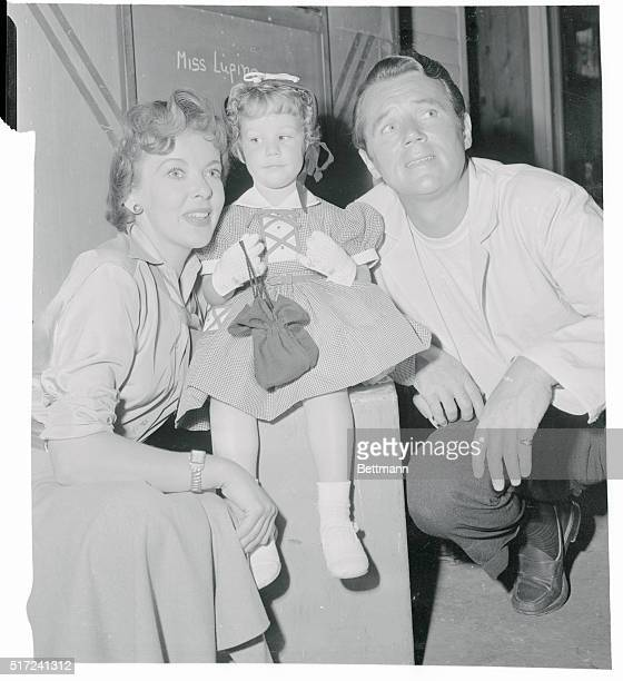 Bridget Duff seems unimpressed by her famous parents Ida Lupino and Howard Duff or the cameraman about to take pictures as she visits the movie set...