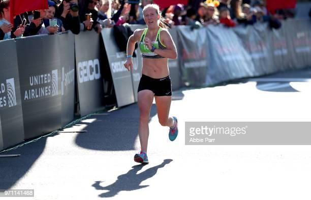 Bridget End crosses the finish line to finish third in the Women's 1/2 Marathon during the St Jude Rock 'n' Roll Seattle Marathon 1/2 Marathon on...