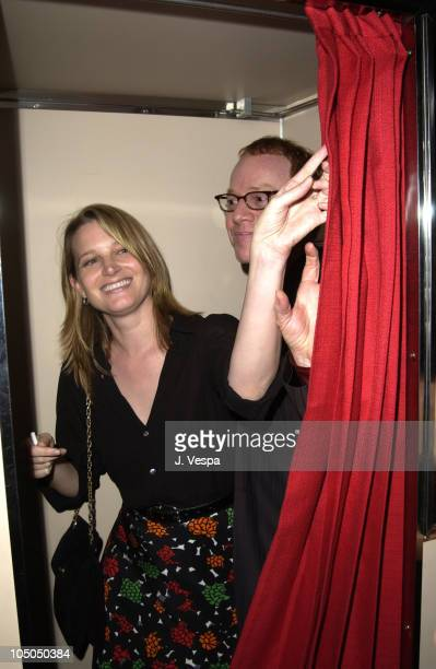 Bridget Fonda and composer Danny Elfman in Brett Ratner's photobooth. Ratner is doing a book of photobooth pictures and he is donating all of the...