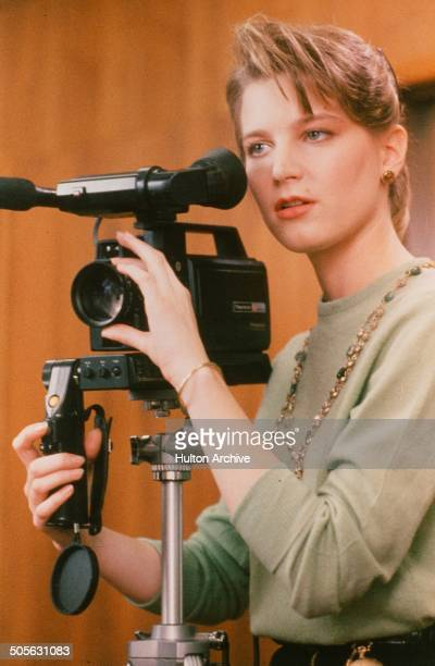 Bridget Fonda video tapes in a scene from the movie You Can't Hurry Love circa 1988