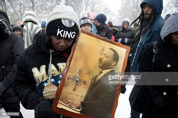 TOPSHOT Bridget Johnson bows her head in prayer at the beginning of Denver's Martin Luther King Jr parade on January 2017 Denver's Martin Luther King...
