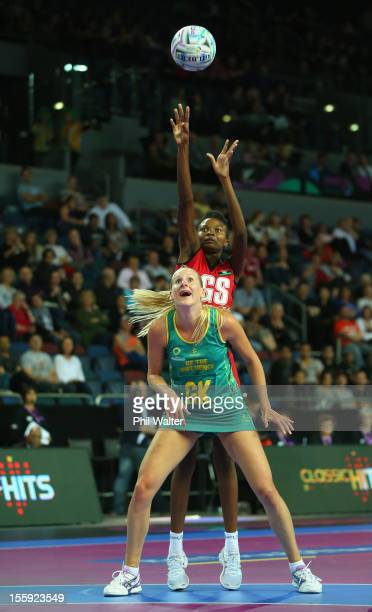 Bridget Kumwenda of Malawi shoots over the top of April Letton of Australia in the game between Australia and Malawi during day one of the Fast5...