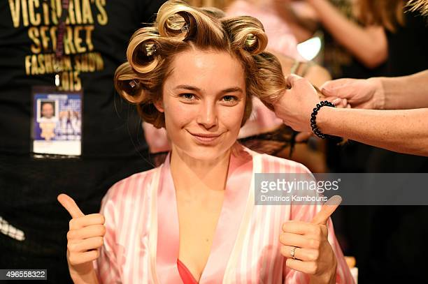 Bridget Malcolm prepares backstage before the 2015 Victoria's Secret Fashion Show at Lexington Avenue Armory on November 10 2015 in New York City