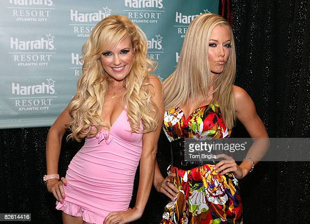 Bridget Marquardt and Kendra Wilkinson from The Girls Next Door pose for photographs before entering The Pool at Harrah's on August 30 2008 in...