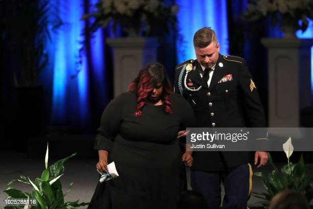 Bridget McCain is escorted her brother during a memorial service to celebrate the life of of US Sen John McCain at the North Phoenix Baptist Church...