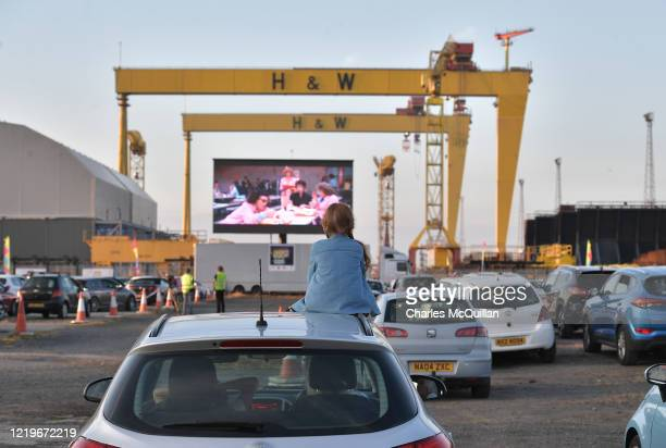 Bridget Nolan watches Grease on the big screen from the roof of her mothers car in the Titanic Quarter beneath the famous Harland and Wolff cranes on...