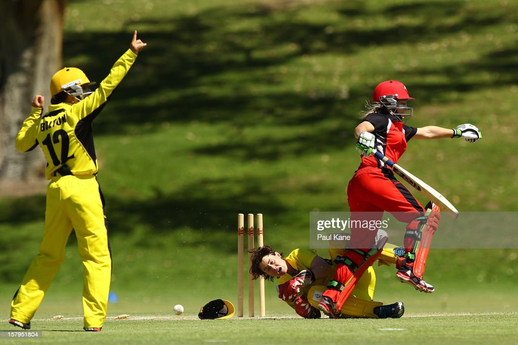 Bridget Patterson of the Scorpions collides with Jenny Wallace of the Fury after being run out during the WNCL match between the Western Australia Fury and the South Australia Scorpions at on December 8, 2012 in Perth, Australia.
