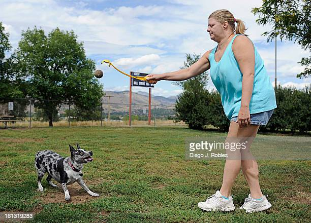 Bridget Ratti plays catch with her Blue Heeler/ Australian Shepherd mix Sissy in Golden's Ulysses Park on Wednesday afternoon Sept 8 2010 Diego James...