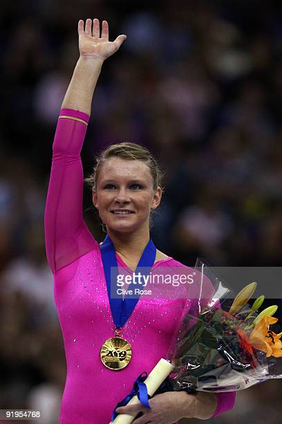 Bridget Sloan of USA celebrates with her medal after she won gold during the Women's All Round Final on the fourth day of the Artistic Gymnastics...