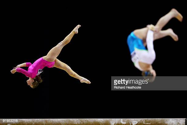 Bridget Sloan of USA competes in the balance beam event next to Ksenia Semenova of Russia during the Women's All Round Final on the fourth day of the...