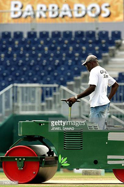 Groundsman steers a roller of the crease at the Kensington Oval in Bridgetown, 27 April 2007, in preparation for the ICC Cricket World Cup 2007 final...