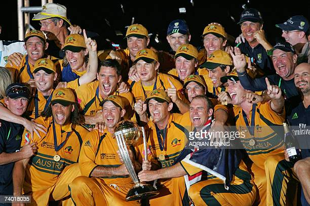 Australian cricket captain Ricky Ponting, Adam Gilchrist, and Matthew Hayden hold the ICC Cricket World Cup Trophy with the squad after beating Sri...