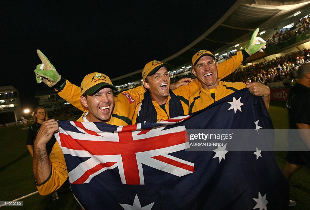 Australian cricket captain Ricky Ponting, (L) Adam Gilchrist (C) and Matthew Hayden (R) hold their national flag as they celebrate beating Sri Lanka in the final of the ICC Cricket World Cup 2007, at the Kensington Oval stadium in Bridgetown, in Barbados, 28 April 2007. Australia beat Sri Lanka by 53 runs here on Saturday to win the World Cup for the third successive time and fourth overall.
