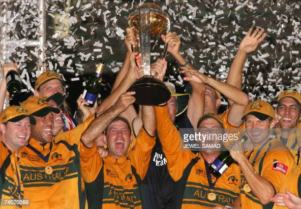 Australian cricket captain Ricky Ponting and his teammates celebrate with the trophy of the ICC Cricket World Cup 2007 at the Kensington Oval in...