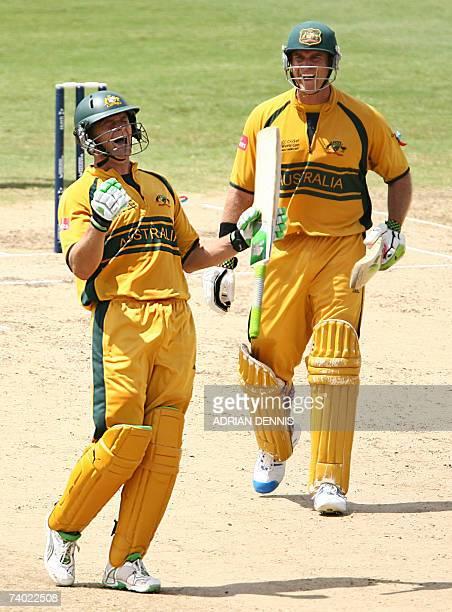 Australian cricketer Adam Gilchrist celebrates with teammate Matthew Hayden after scoring a century against Sri Lanka at the Kensington Oval stadium...