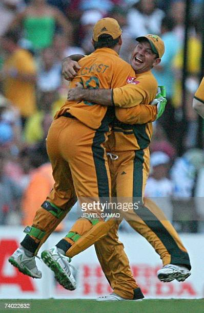 Australian cricketer Adam Gilchrist is embraced by captain Ricky Ponting after they beat Sri Lanka in the final of the ICC Cricket World Cup Final...