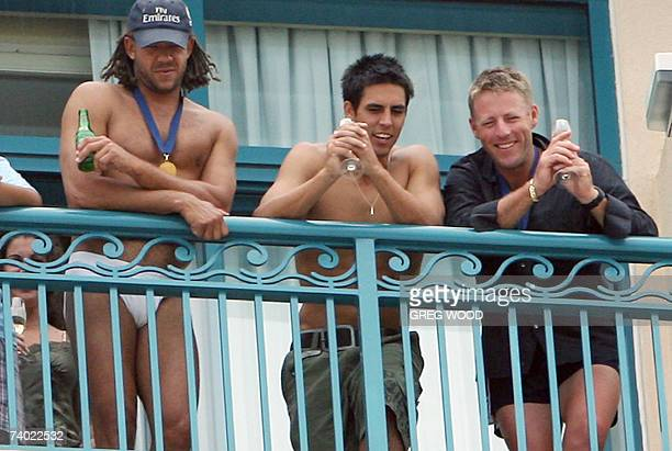Australian cricketer Andrew Symonds and his teammate Mitchell Johnson look at their captain Ricky Ponting from their hotel balcony in Bridgetown, 29...