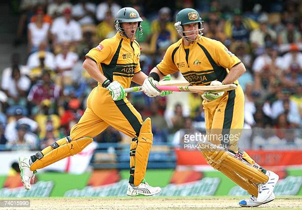 Australian cricketers Adam Gilchrist and Matthew Hayden run between the wicket during the final match of the ICC Cricket World Cup 2007 between...