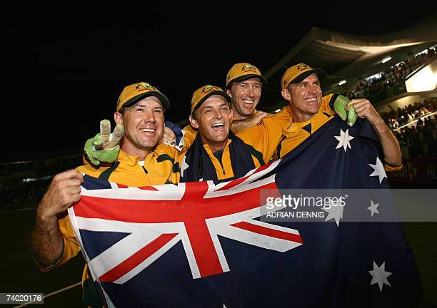 Australian cricketers captain Ricky Ponting Adam Gilchrist Glenn McGrath and Matthew Hayden pose for photos with their national flag as they...