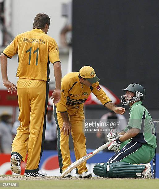 Australia's Captain Ricky Ponting checks on Ireland's Andrew White after he took a ball to the head off the bowling of Glenn McGrath during the...