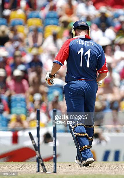 England's Andrew Flintoff walks back to the dressing room after being cleaned bowled by South Africa's Andrew Hall during the Super-Eight ICC World...
