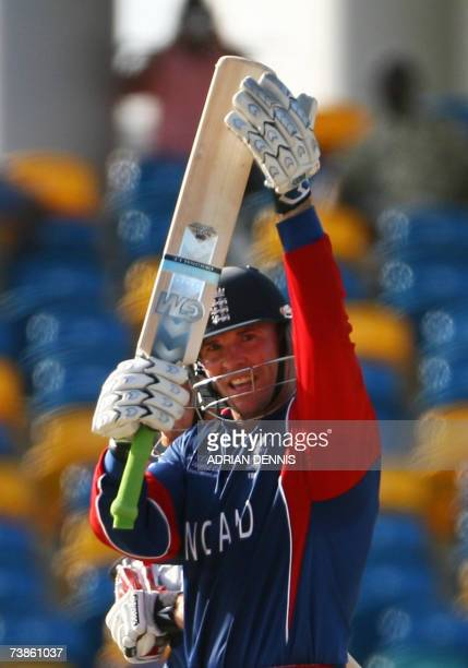 England's Paul Nixon salutes the crowd after hitting a boundary to win the game against Bangladesh during the game against Bangladesh during their...