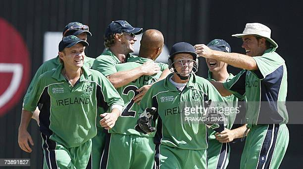 Ireland's Wicket keeper Niall O'Brien and Captain Trent Johnston celebrates the wicket of Bangladesh's Aftab Ahmed with teammates during the...