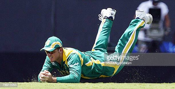 South Africa's Captain Graeme Smith dives successfully to take the catch of England's Kevin Pietersen bowled by Andre Nel , during their ICC World...