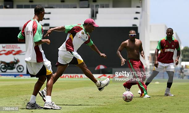 West Indies Captain Brian Lara plays a warmup football game with teammates during training at the Kensington Oval in Bridgetown Barbados 20 April...