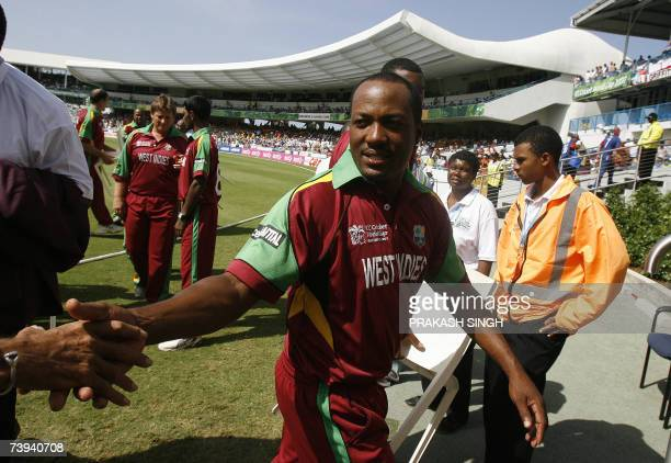 West Indies Captain Brian Lara shakes hands with a photographer after the team photo at the Kensington Oval in Bridgetown Barbados 21 April 2007 The...