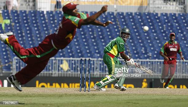 West Indies's Captain Brian Lara drops the catch of Bangladesh's Javed Omar during their ICC World Cup super-eights match at the Kensington Oval in...