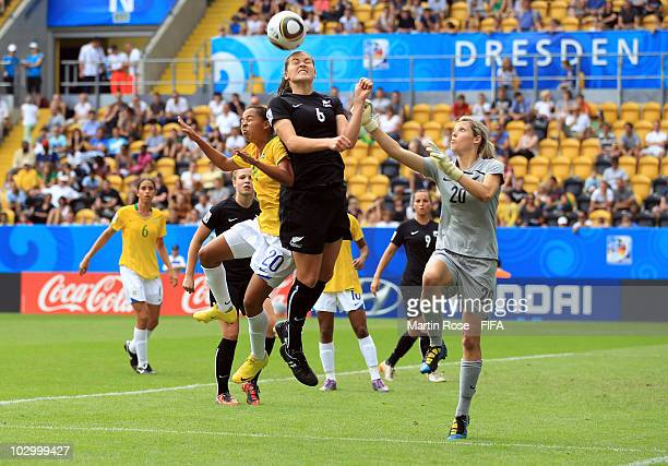 Bridgette Armstrong of New Zealand and Ludmila of Brazil jump for a header during the 2010 FIFA Women's World Cup Group B match between New Zealand...