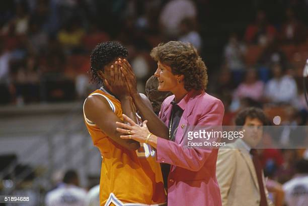 Bridgette Gordon of the Tennessee Lady Vols covers her face and talks to coach Pat Summit in the Final Four game against Long Beach State during the...