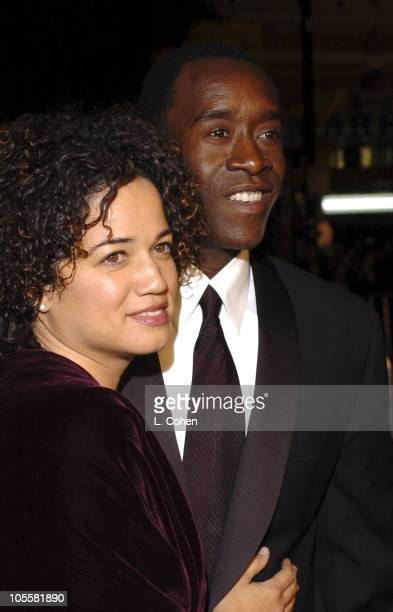 Bridgid Coulter and Don Cheadle during Ocean's Twelve Los Angeles Premiere Red Carpet at Grauman's Chinese Theater in Los Angeles California United...
