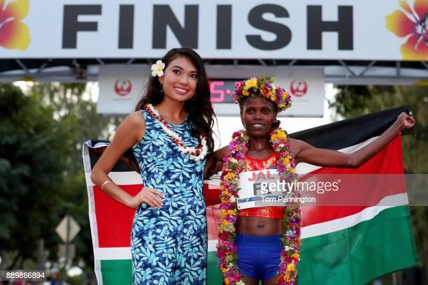 Bridgid Kosei of Kenya poses with Miss Hawaii USA 2018 Julianne Chu after winning the Women's division of the Honolulu Marathon 2017 on December 10...