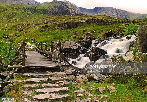 bridging the waterfall - snowdonia stock photos and pictures
